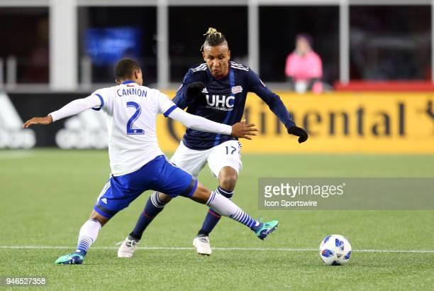 New England Revolution forward Juan Agudelo defended by FC Dallas defender Reggie Cannon during a match between FC Dallas and New England Revolution...