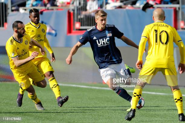 New England Revolution forward Justin Rennicks surrounded by Crew players during a match between the New England Revolution and Columbus Crew SC on...