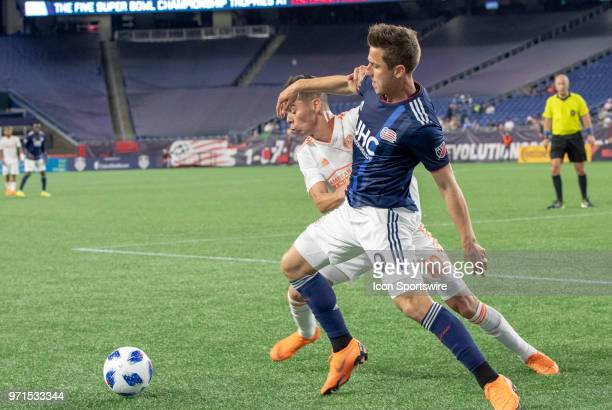 New England Revolution forward Krisztian Nemeth battles with Atlanta United FC midfielder Miguel Almiron during a match between the New England...