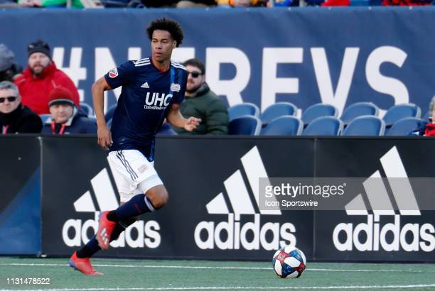 New England Revolution forward Tajon Buchanan carries the ball on the wing during a match between the New England Revolution and Columbus Crew SC on...