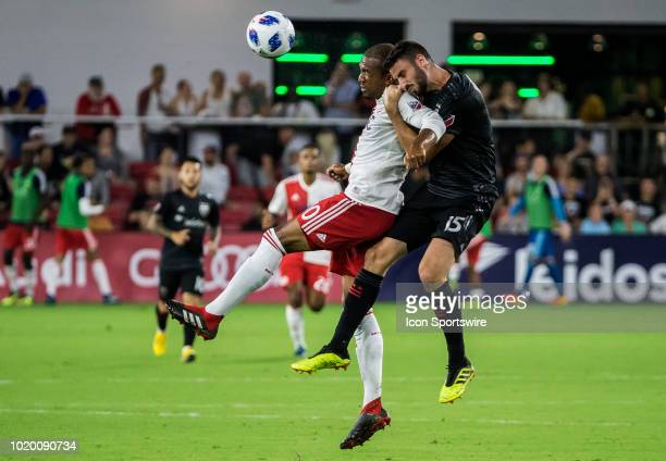 New England Revolution forward Teal Bunbury and DC United defender Steve Birnbaum clash going for a header during a MLS match between DC United and...