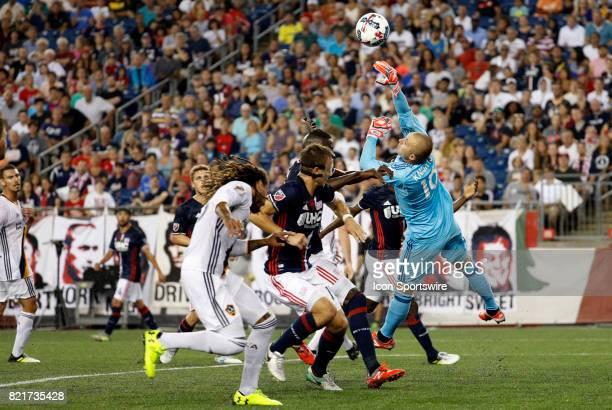 New England Revolution goalkeeper Brad Knighton knocks a corner kick away during a regular season MLS match between the New England Revolution and...