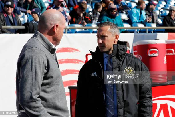 New England Revolution head coach Brad Friedel and Columbus Crew head coach Caleb Porter speak before a match between the New England Revolution and...