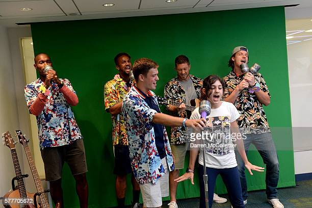 New England Revolution Jose Goncalves Darrius Barnes Kelyn Rowe Chris Tierney and Bobby Shuttleworth sing karaoke with Lydia at Boston Children's...