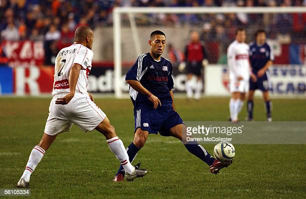 New England Revolution midfielder Clint Dempsey kicks the ball past Chicago Fire defender C J Brown during the Eastern Conference Championships at...
