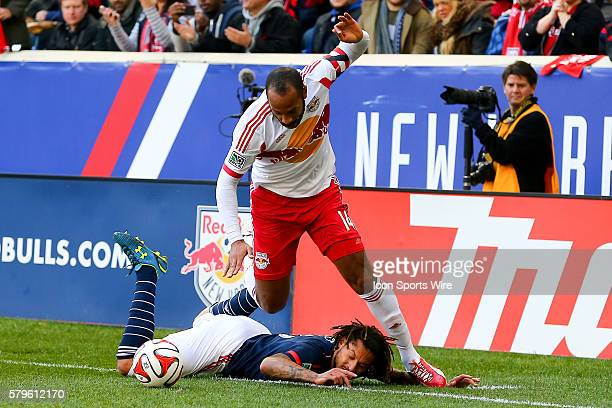 New England Revolution midfielder Jermaine Jones falls after being fouled by New York Red Bulls forward Thierry Henry during the first half of the...