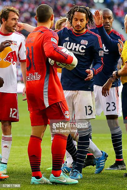 New England Revolution midfielder Jermaine Jones tries to get the ball from New York Red Bulls goalkeeper Luis Robles during the second half of the...