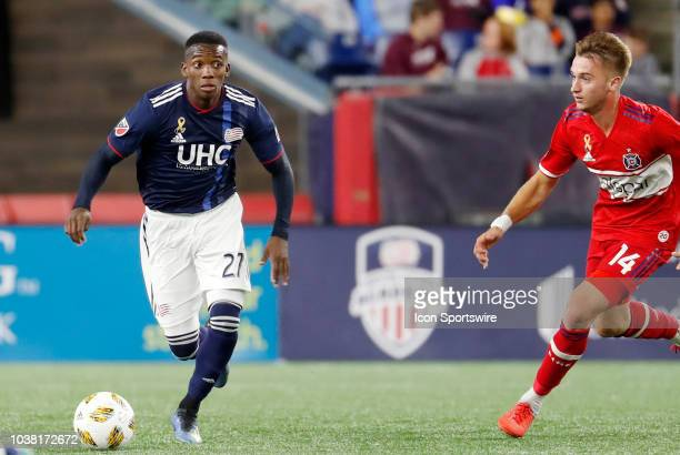 New England Revolution midfielder Luis Caicedo moves past Chicago Fire midfielder Djordje Mihailovic during a match between the New England...