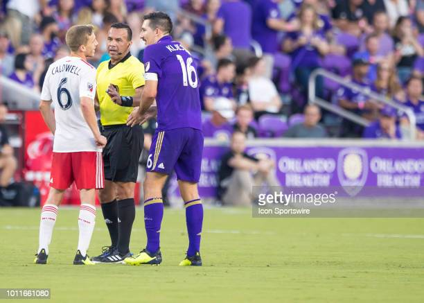 New England Revolution midfielder Scott Caldwell and Orlando City midfielder Sacha Kljestan have words during the MLS soccer match between the...
