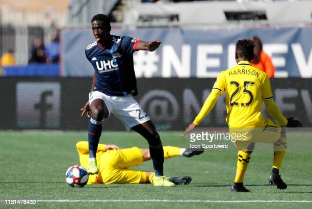 New England Revolution midfielder Wilfried Zahibo cuts away from Columbus Crew defender Harrison Afful during a match between the New England...