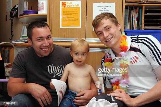 New England Revolution player Zak Boggs brings summer fun to Lucas at Children's Hospital Boston on June 29 2011 in Boston Massachusetts