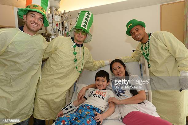 New England Revolution Tyler Rudy Kelyn Rowe and Charlie Davies visit Matthew and Mom at Boston Children's Hospital March 10 2015 in Boston...