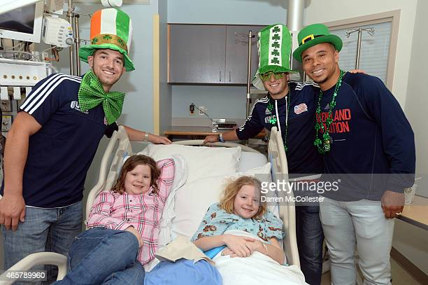 New England Revolution Tyler Rudy Kelyn Rowe and Charlie Davies visit Samantha and sister Chloe at Boston Children's Hospital March 10 2015 in Boston...