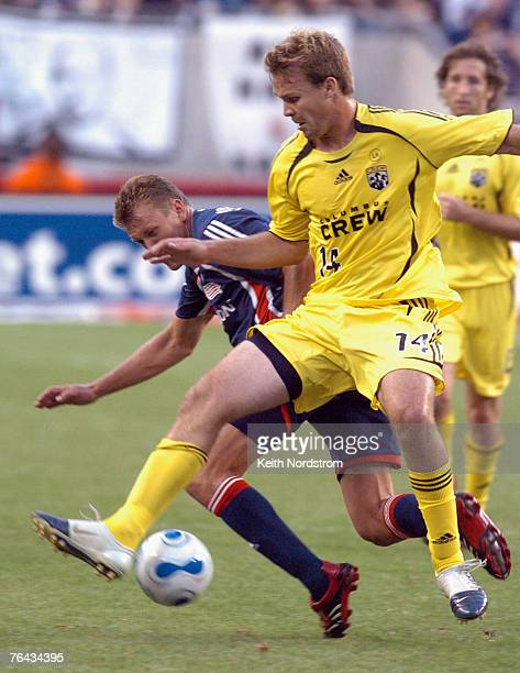 New England Revolution's Adam Cristman collides with Columbus Crew's Chad Marshall during MLS action at Gillette Stadium in Foxborough Massachusetts...