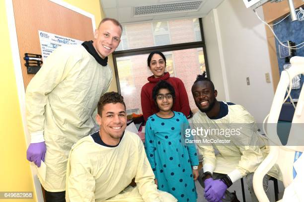 New England Revolution's Cody Cropper Joshua Smith and Kei Kamara visit Vai and Mom at Boston Children's Hospital on March 8 2017 in Boston...