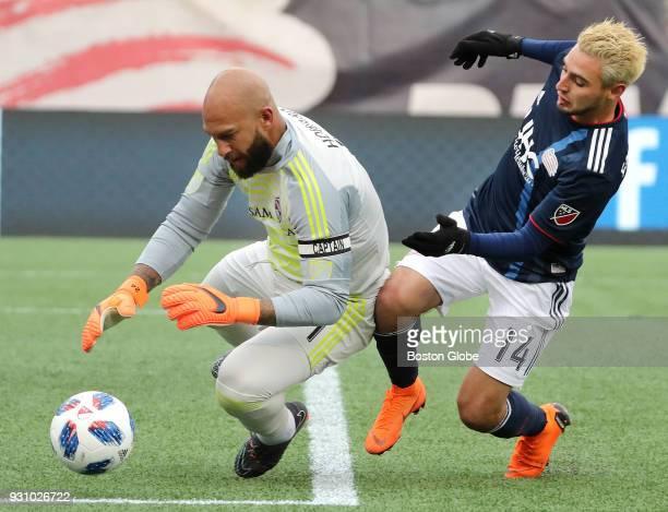 New England Revolution's Diego Fagundez puts pressure on Colorado Rapids goalie Tim Howard during the second half The New England Revolution host the...