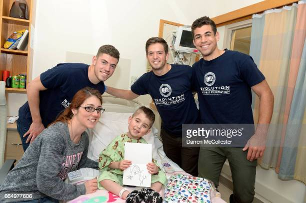 New England Revolution's Donnie Smith Kelyn Rowe and Joshua Smith visit Logan at Boston Children's Hospital April 5 2017 in Boston Massachusetts