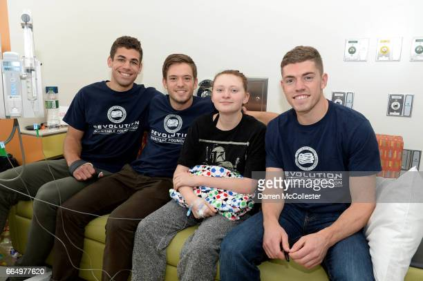 New England Revolution's Joshua Smith Kelyn Rowe and Donnie Smith visit Rory at Boston Children's Hospital April 5 2017 in Boston Massachusetts