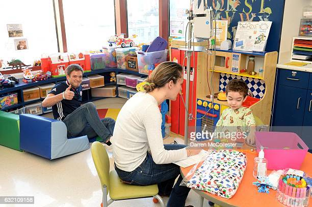New England Revolutions Kelyn Rowe hands out Binkeez blankets to the kids at Boston Children's Hospital on January 19 2017 in Boston Massachusetts