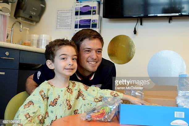 New England Revolutions Kelyn Rowe takes a picture with Ethan at Boston Children's Hospital on January 19 2017 in Boston Massachusetts