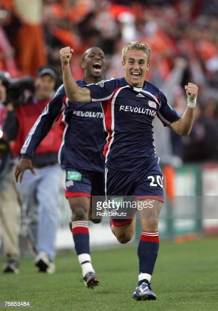 New England Revolutions' Taylor Twellman and Avery John celebrate Twellman's goal by running down field to the Revolution's supporters against the...