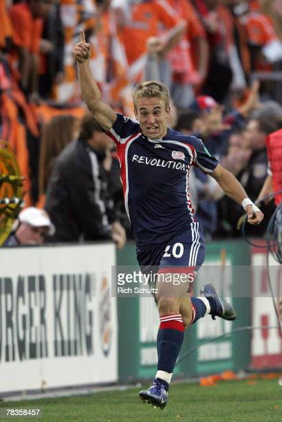 New England Revolutions' Taylor Twellman celebrates his goal by running down field to the Revolution's supporters against the Houston Dynamo during...