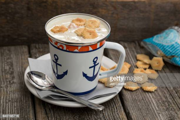 new england style clam chowder - new england clam chowder stock photos and pictures
