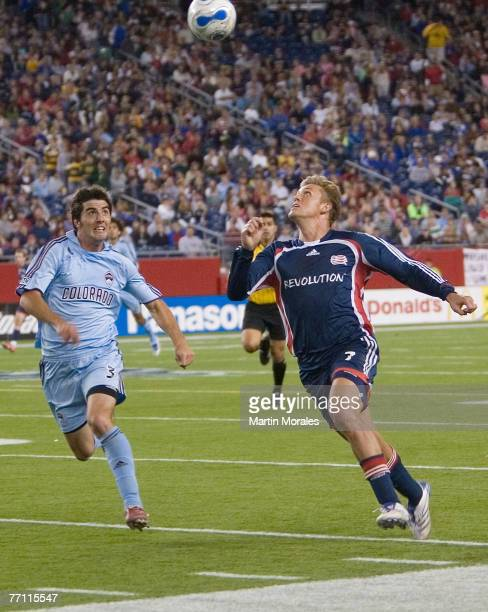 New England's Adam Cristman is chased by Colorado Rapids defender Facundo Erpen during a match between the New England Revolution and Colorado Rapids...