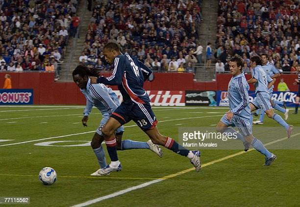 New England's Khano Smith is chased by Colorado Rapid defenders during a match between the New England Revolution and Colorado Rapids September 29...