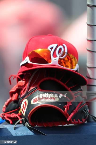 A new Era cap and Wilson glove of a Washington Nationals player during a spring training baseball game against the Atlanta Braves at Fitteam Ballpark...
