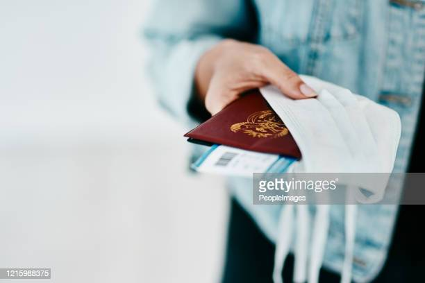 new essentials for a covid-19 traveller - emigration and immigration stock pictures, royalty-free photos & images