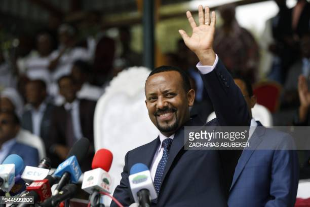New Ethiopian Prime Minister Abiy Ahmed reacts during his rally in Ambo, about 120km west of Addis Ababa, Ethiopia, on April 11, 2018. / AFP PHOTO /...
