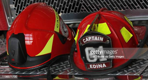New Euro style fire helmet with built in light and visors and older traditional fire hat Photographed on 3/7/13 In a proud profession like...