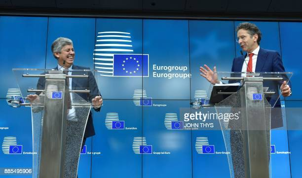 New Eurogroup President Portuguese Finance Minister Mario Centeno and former Dutch Finance Minister and parting Eurogroup president Jeroen...