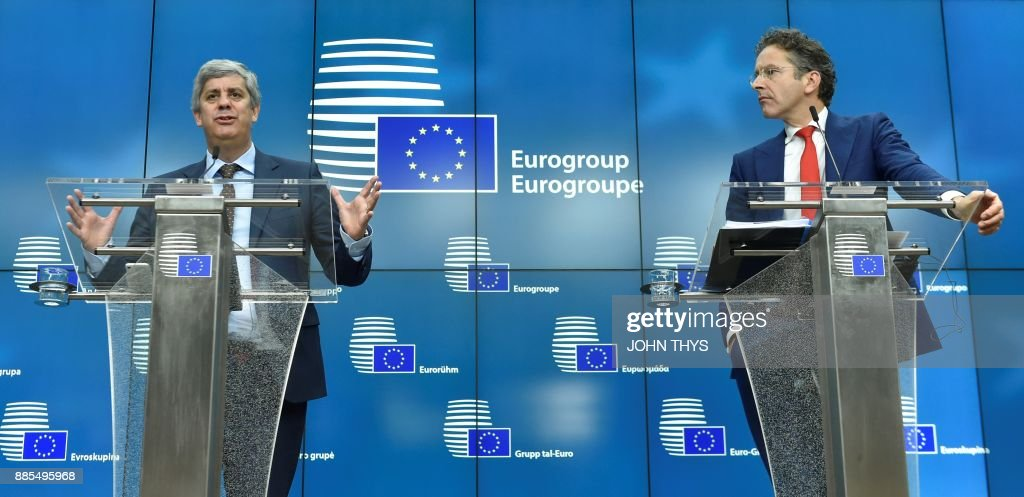 New Eurogroup President Portuguese Finance Minister Mario Centeno (L) and former Dutch Finance Minister and parting Eurogroup president Jeroen Dijsselbloem address a press conference on Centeno's election as new Eurogroup chief at the European Council in Brussels on December 4, 2017. The 50-year-old economics professor who is often called a liberal but sees himself 'culturally of the left' accedes to the top post among eurozone finance ministers after only two years in politics. /