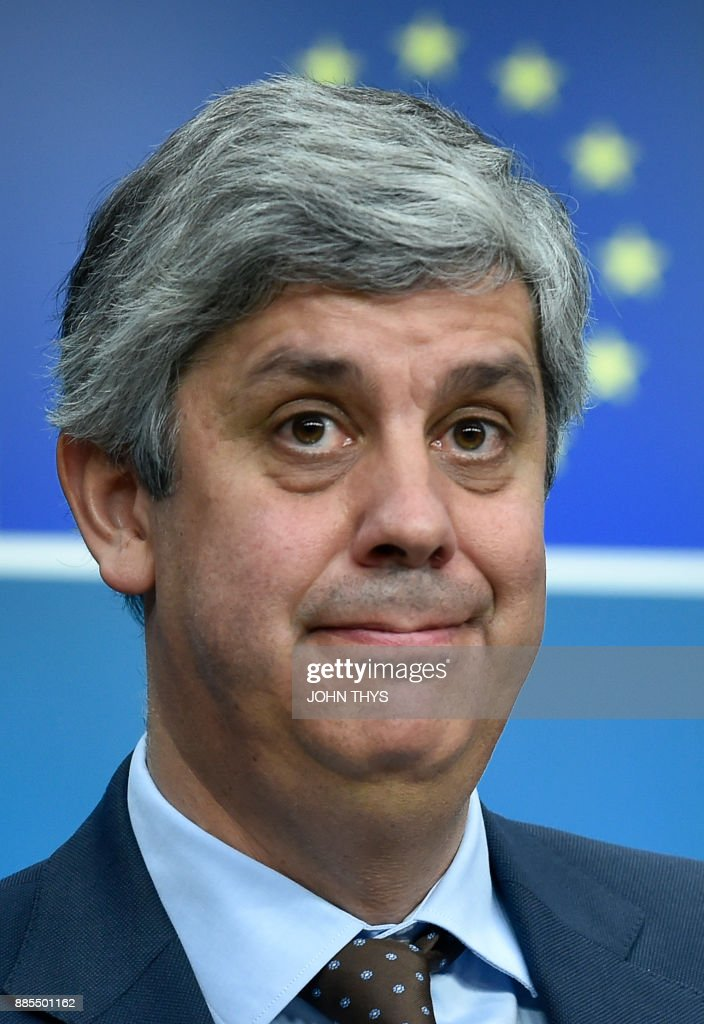 New Eurogroup President Portuguese Finance Minister Mario Centeno looks on as he addresses a press conference at the European Council in Brussels on December 4, 2017. /