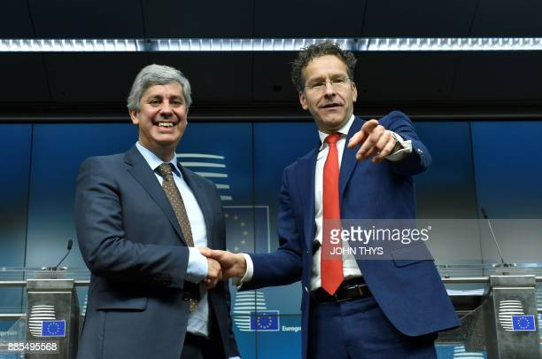 New Eurogroup President Portuguese Finance Minister Mario Centeno shakes hands with former Dutch Finance Minister and parting Eurogroup president...