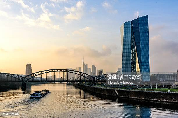 New European Central Bank Headquarters at sunset viewed from the Osthafenbruecke over the Main river in Frankfurt Germany 07 December 2014 The ECB...