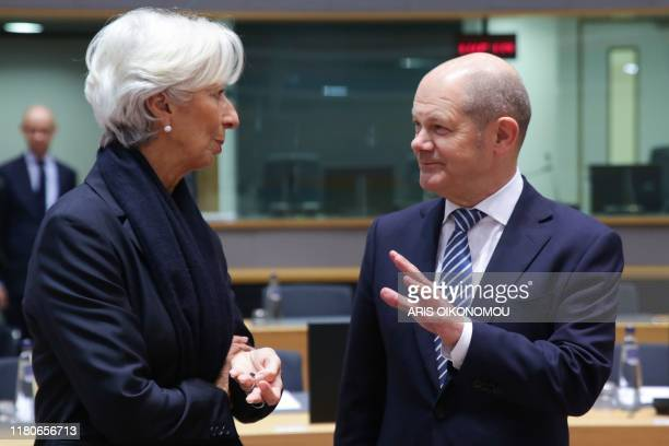 New European Central Bank President Christine Lagarde speaks with German Finance Minister and ViceChancellor Olaf Scholz as she arrives for her first...