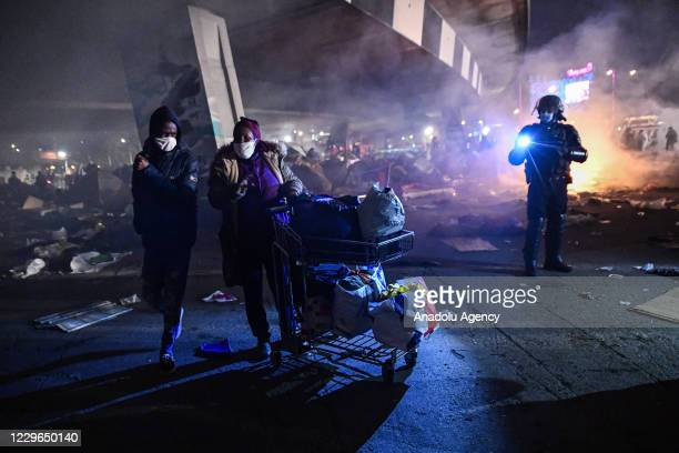 New evacuation of the migrant camp takes place at the gate of Paris, near Saint Denis at dawn on November 17, 2020. Several thousand refugees were...