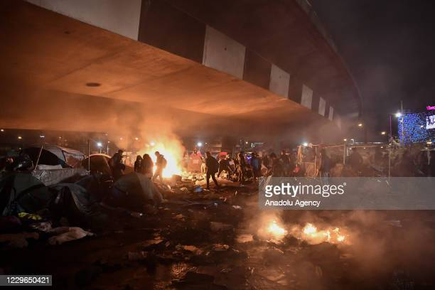 New evacuation of the migrant camp takes place at the gate of Paris near Saint Denis at dawn on November 17 2020 Several thousand refugees were...