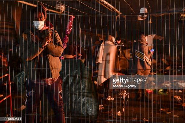 New evacuation of the migrant camp takes place at the gate of Paris, near Saint Denis on November 17, 2020. Several thousand refugees were sheltered...