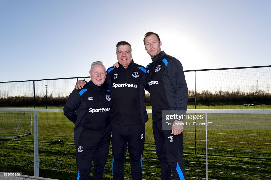 New Everton manager Sam Allardyce (C) poses for a photograph with new assistant manager Sammy Lee and first team coach Duncan Ferguson after the Everton training session at USM Finch Farm on December 1, 2017 in Halewood, England.