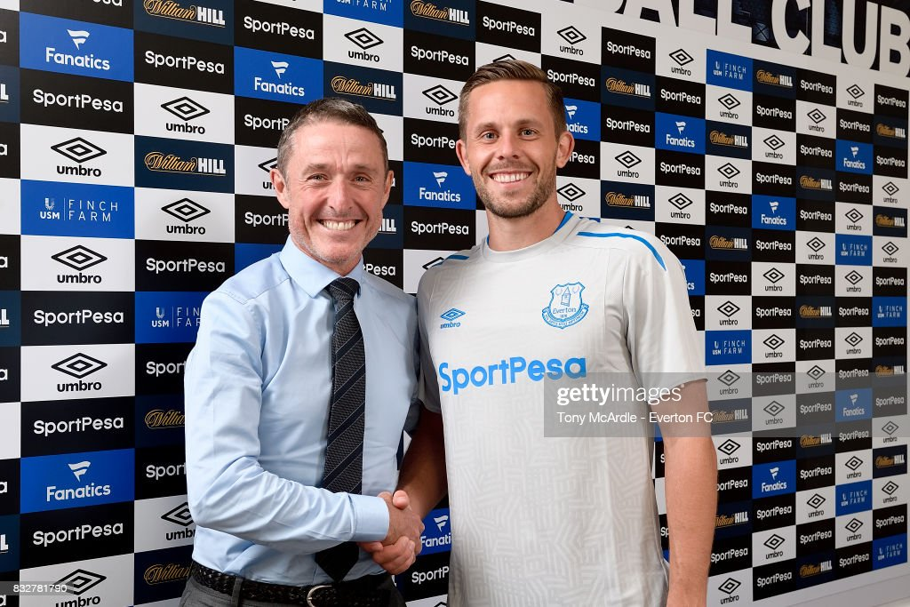 New Everton signing Gylfi Sigurdsson poses for a photo with Robert Elstone at USM Finch Farm on August 16, 2017 in Halewood, England.