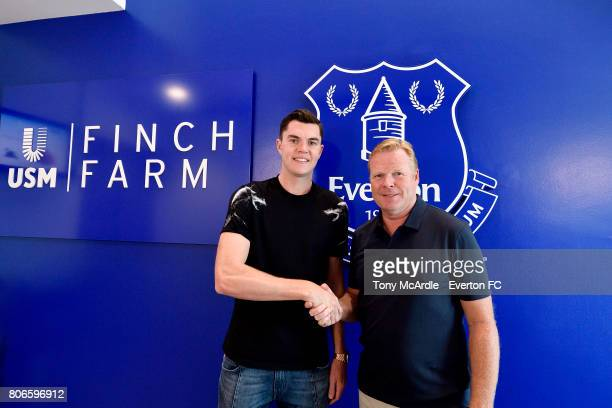 New Everton signing Michael Keane poses for a photo with Ronald Koeman at USM Finch Farm on July 3 2017 in Halewood England