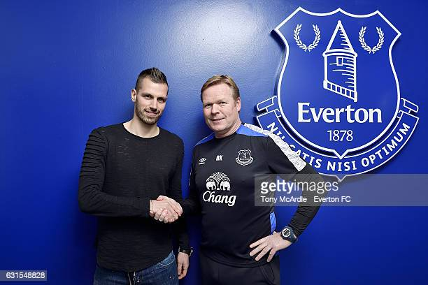 New Everton signing Morgan Schneiderlin is welcomed by Ronald Koeman at USM Finch Farm on January 11 2017 in Halewood England