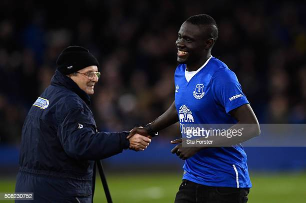 New Everton signing Oumar Niasse shakes hands with a member of groundstaff prior to kickoff during the Barclays Premier League match between Everton...