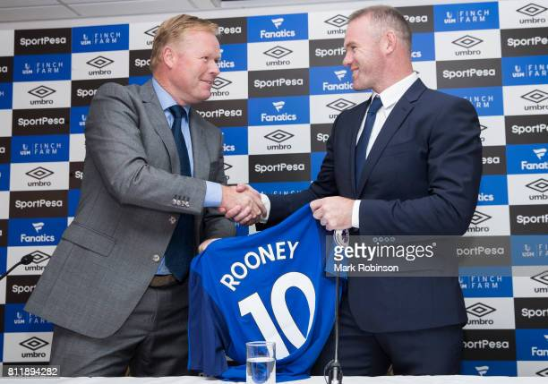 New Everton Signing Wayne Rooney is given his shirt by Manager Ronald Koeman at Goodison Park on July 10 2017 in Liverpool England