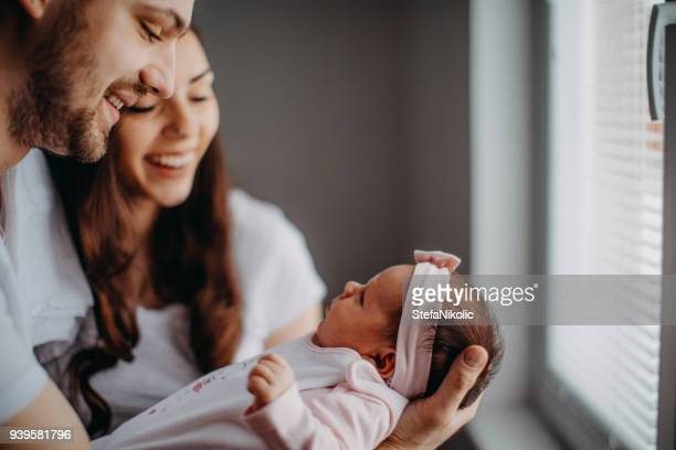 new family member, baby girl - parent stock pictures, royalty-free photos & images