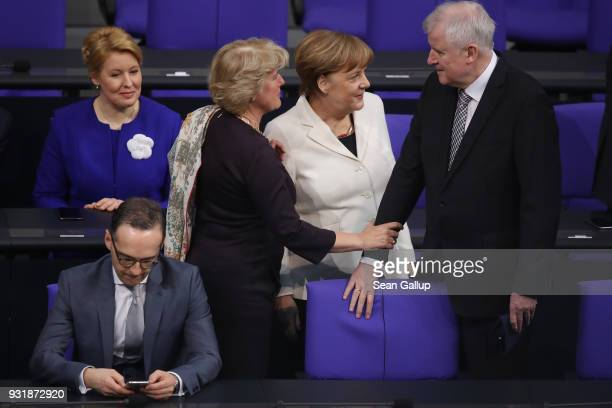 New Family Minister Franziska Giffey Foreign Minister Heiko Maas State Culture Minister Monika Gruetters Chancellor Angela Merkel and new Interior...